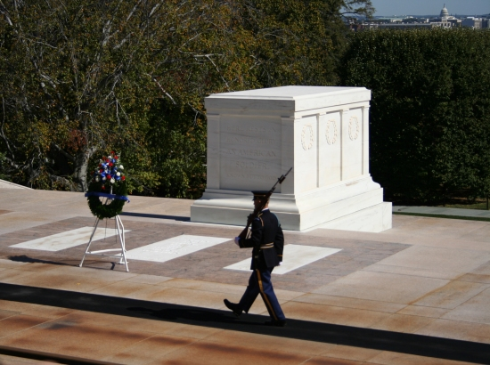 Tomb of the unknown soldier Arlington cemetary with honour guard marching