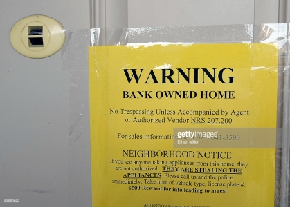 LAS VEGAS - NOVEMBER 13: A warning sign is posted on the front door of a foreclosed home November 13, 2008 in Las Vegas, Nevada. A report by RealtyTrac Inc. found that Nevada had the highest foreclosure rate in the nation for the 22nd consecutive month in October with one in every 74 homes receiving a foreclosure filing. (Photo by Ethan Miller/Getty Images)